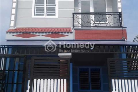 Nhà bán 1 trệt 1 lầu với 4 phòng ngủ mới 100%, sổ hồng riêng, đường Đinh Đức Thiện Bình Chánh