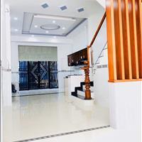 Bán nhà mới 1 trệt 2 lầu, mặt tiền 18m, Quốc lộ 50, sổ hồng riêng