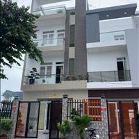 Cần bán gấp nhà 1 trệt 2 lầu mặt tiền đường Hương lộ 11 tiện kinh doanh sổ hồng riêng mới xây dựng