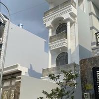 Bán nhà kiểu thiết kế 1 trệt 3 lầu đường nhựa trước nhà 12m