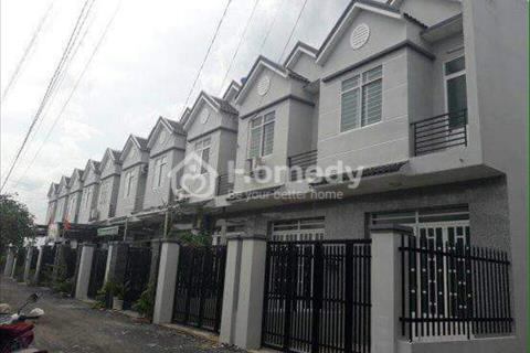 Cần tiền bán nhà gấp 1 trệt 1 lầu, 100 m2 gần chợ Bình Chánh, sổ hổng riêng, nhà đẹp 100%
