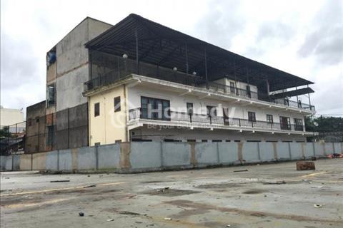 Bán đất Nguyễn Văn Linh 25 x 74, gần cầu Tân Thuận, giá 75 triệu/m2 có nhà 2 lầu.